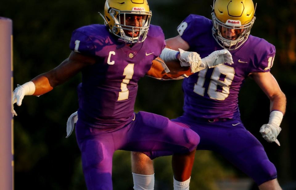 <strong>CBHS running back Dallan Hayden (1) celebrates with teammate Sam Wallace (18) after scoring a touchdown during an Aug. 21 game against Germantown.</strong> (Patrick Lantrip/Daily Memphian)
