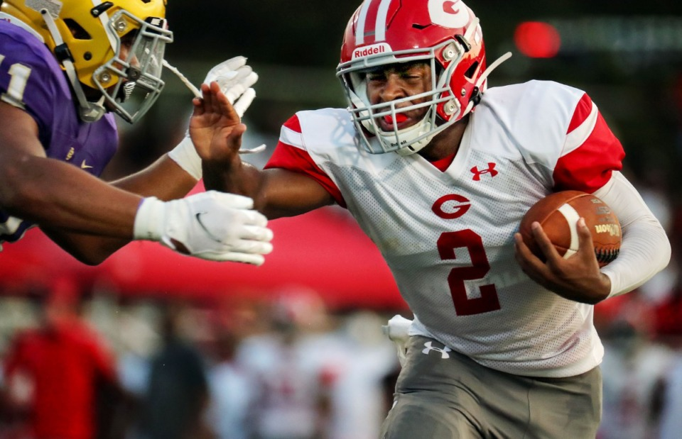 <strong>Germantown running back Malik Young (2) tries to dodge a CBHS defender during an Aug. 21, 2021 game.</strong> (Patrick Lantrip/Daily Memphian)