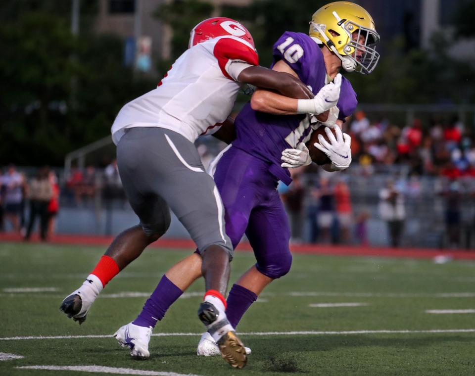 <strong>CBHS receiver William Keith (10) hauls in a catch during an Aug. 21 game against Germantown.</strong> (Patrick Lantrip/Daily Memphian)