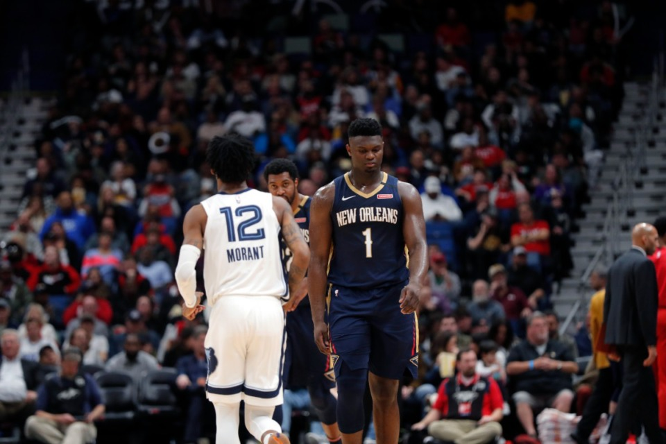 <strong>New Orleans Pelicans forward Zion Williamson (1) walks past Memphis Grizzlies guard Ja Morant (12) in the second half of an NBA basketball game in New Orleans, Friday, Jan. 31, 2020. The Pelicans won 139-111. New Orleans does not play in Memphis this season until March 8, 2022.</strong> (AP Photo/Gerald Herbert file)