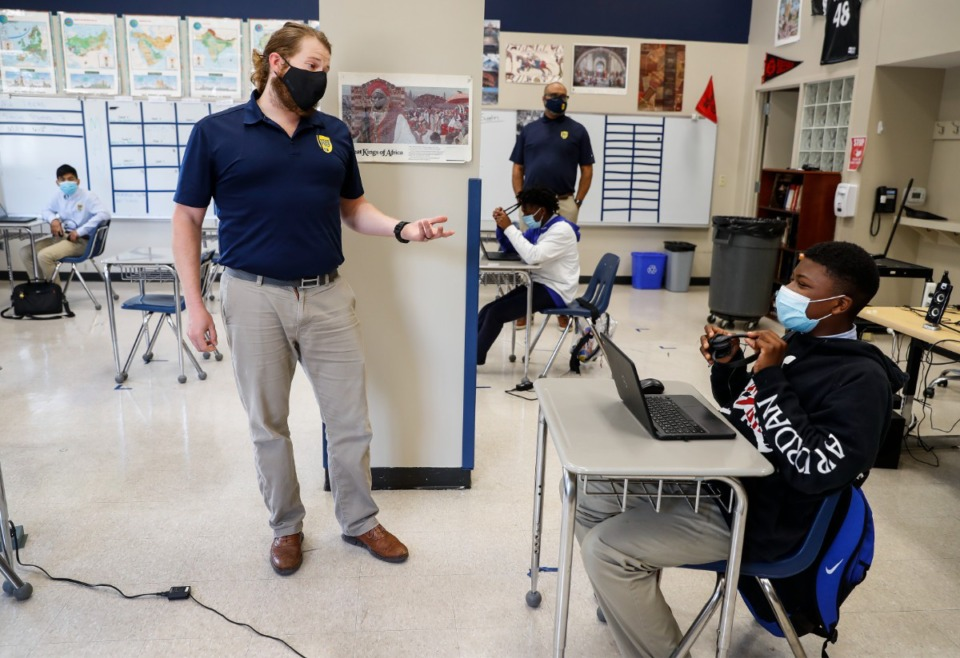 <strong>Social studies teacher Alex Iberg (in a May 27 file photo) chats with students at Grizzlies Prep. County Commissioner Mick Wright says, &ldquo;Keeping kids in quarantine would be safer than allowing them to gather together indoors, with or without masks. Few people here support permanent isolation, but it could certainly limit the reach of multiple viruses, and that&rsquo;s a pretty compelling option if slowing the spread is our sole consideration.&rdquo;</strong> (Mark Weber/The Daily Memphian)