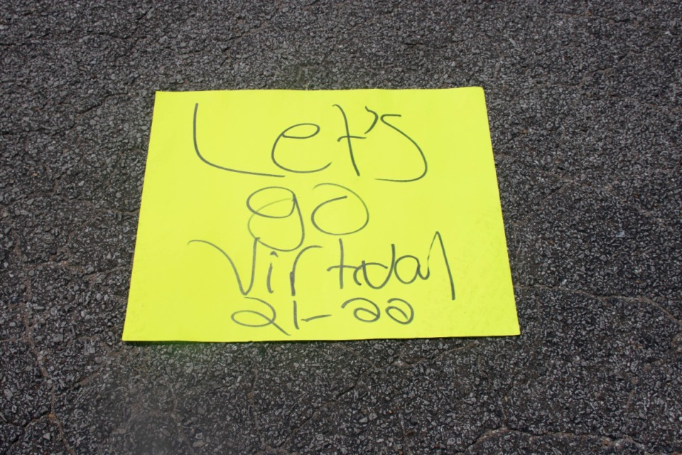 <strong>A protestor's sign read&nbsp;&ldquo;Let&rsquo;s go virtual 21-22&rdquo; at the Shelby County Board of Education on Monday, Aug. 23.</strong> (Daja E. Henry/Daily Memphian)