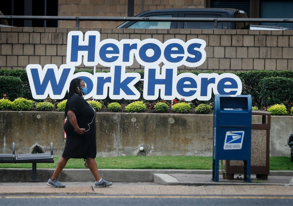 <strong>A Regional One Health staff member walks along Jefferson Avenue, on July 19.&nbsp;The County Commission is giving hospital enough funding to hire enough skilled professionals on a temporary contract to open up 21 more beds for 13 weeks.</strong> (Mark Weber/The Daily Memphian)