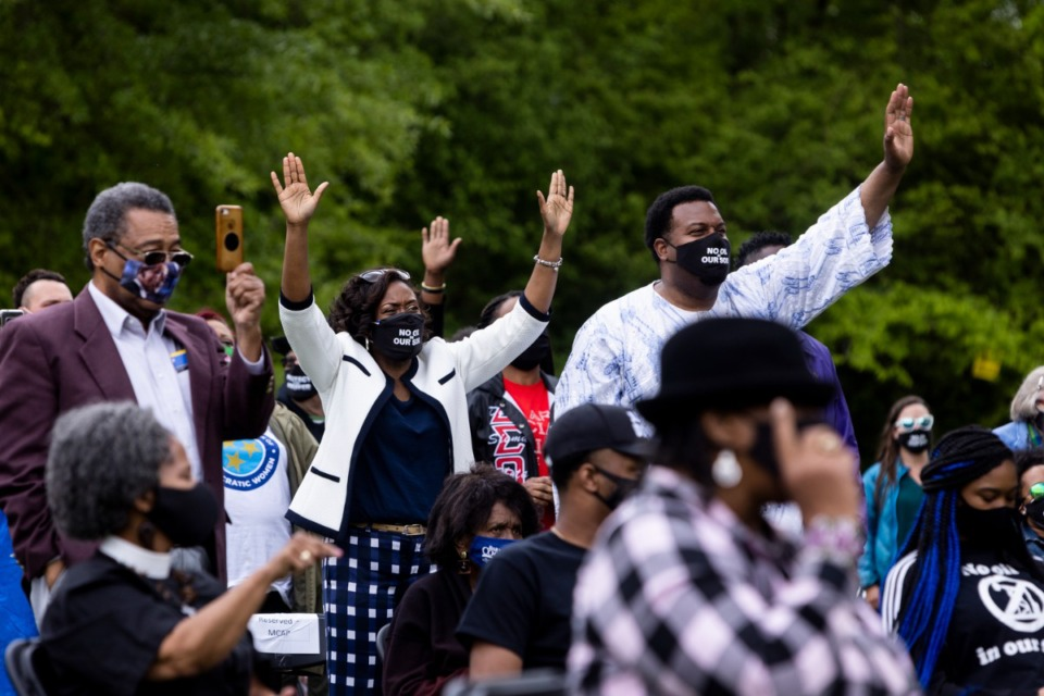 <strong>People react as Rev. Dr. William Barber II, co-chair of the Poor People's Campaign, speaks during a rally supporting Memphis Community Against Pollution at Alonzo Weaver Park</strong>. (Brad Vest/ Special to The Daily Memphian)
