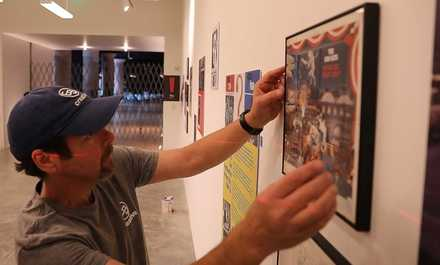 "<strong>Eric Berg puts finishing touches on ""Give a Damn! Music + Activism at Stax Records,"" which draws its name from a 1970s Staple Singers song.</strong> (Patrick Lantrip/Daily Memphian)"