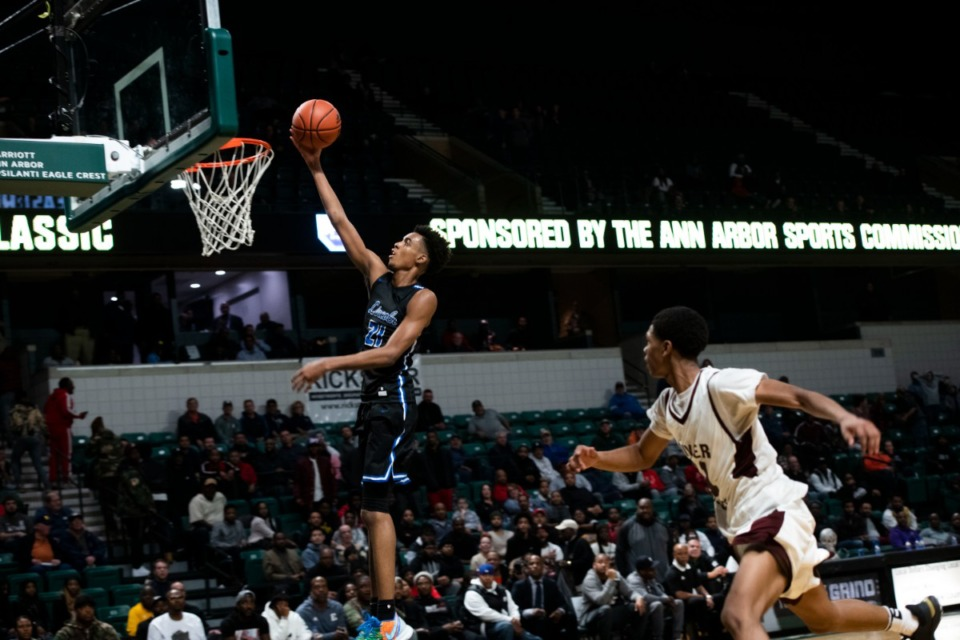 <strong>Ypsilanti Lincoln's Emoni Bates shoots against River Rouge on Dec. 9, 2019.&nbsp;The current No. 5 player in the class of 2021, Bates will decide among Memphis, Oregon, Michigan State and the G League.</strong> (Nicole Hester/Ann Arbor News via Associated Press file)