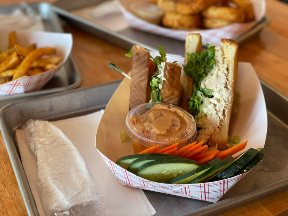<strong>The homemade chicken salad sandwich comes with hummus and fresh vegetables as a side item at Saucy Chicken.</strong> (Jennifer Biggs/The Daily Memphian)