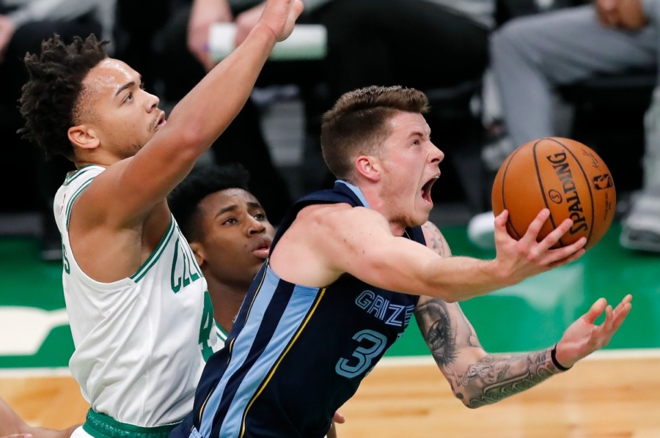 <strong>Memphis Grizzlies' Sean McDermott (right) goes up to shoot against the Boston Celtics on Dec. 30, 2020, in Boston. The Grizzlies waived&nbsp; McDermott on Wednesday, Aug. 25.</strong> (Michael Dwyer/Associated Press file)