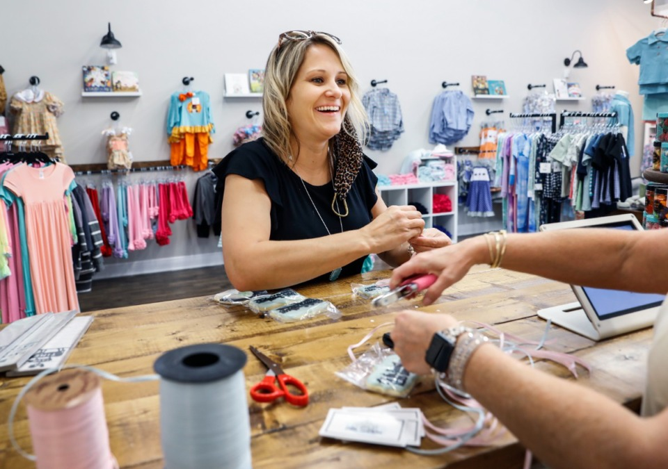 <strong>Elizabeth Miller, co-owner of Little Southern Kids Boutique, prepares for a ribbon-cutting ceremony on Thursday, Aug. 26, at the shop in Arlington&rsquo;s Depot Square.&nbsp;&ldquo;For what was kind of my hobby at first is now turning into our new lifestyle,&rdquo; she said.</strong> (Mark Weber/Daily Memphian)