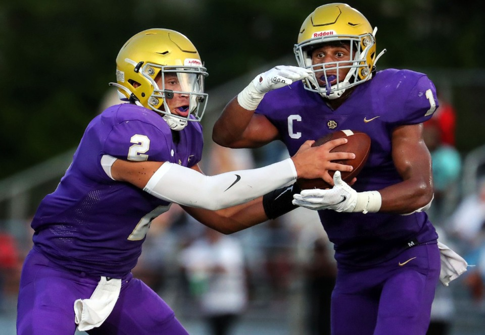 <strong>CBHS quarterback Ashton Strother (2) hands the ball off to running back Dallan Hayden (1) in the Aug. 21 game against Germantown. The Brothers won 20-14 in OT.</strong>&nbsp;(Patrick Lantrip/Daily Memphian)