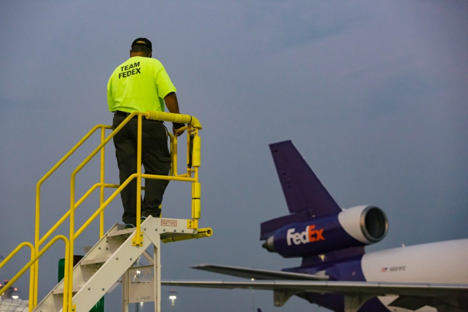 <strong>A FedEx ground crew employee watches from a gantry as relief supplies for Haiti are loaded on a FedEx air freight jet on Aug. 26, 2021.</strong> (Ziggy Mack/Daily Memphian)