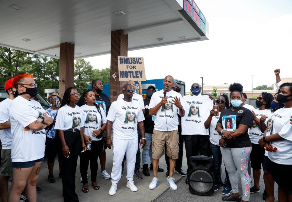 <strong>Dr. Robert Motley (middle), a cousin of Alvin Motley Jr., is surrounded by family members as he speaks during a rally at a Kroger gas station on Poplar on Thursday, Aug. 26. The rally followed a&nbsp; memorial service for Motley, who was shot to death at the gas station, allegedly by a security guard.</strong> (Mark Weber/Daily Memphian)