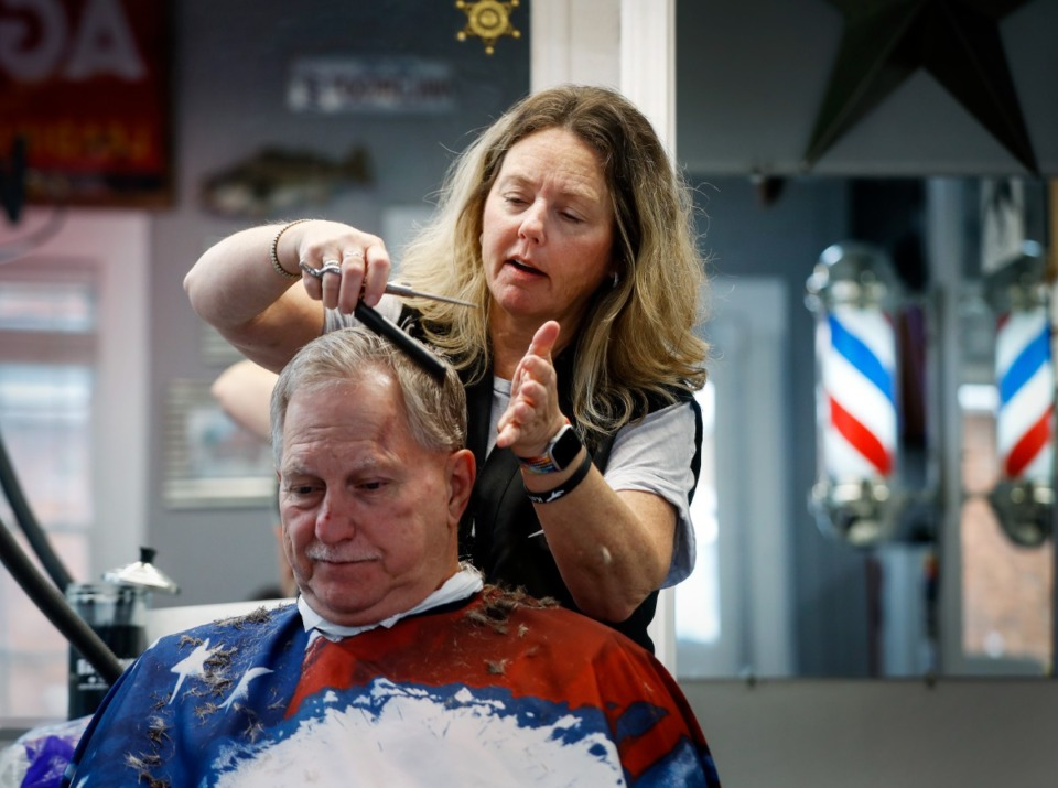 <strong>Shelly's Barber Shop on the Square owner Shelly Pilkington cuts customer Mike Wiseman&rsquo;s hair on Wednesday, Aug. 18, 2021 in Arlington.</strong> (Mark Weber/The Daily Memphian)