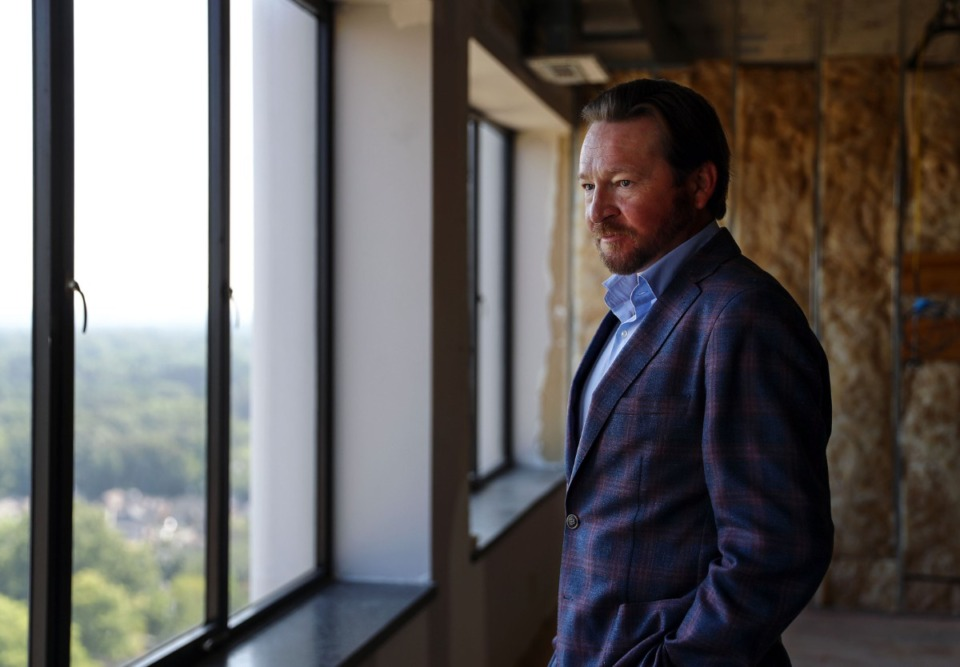 <strong>Jacob Biddle looks out a window while touring one of the Clark Tower's units that&rsquo;s under construction.</strong> (Patrick Lantrip/Daily Mempian)