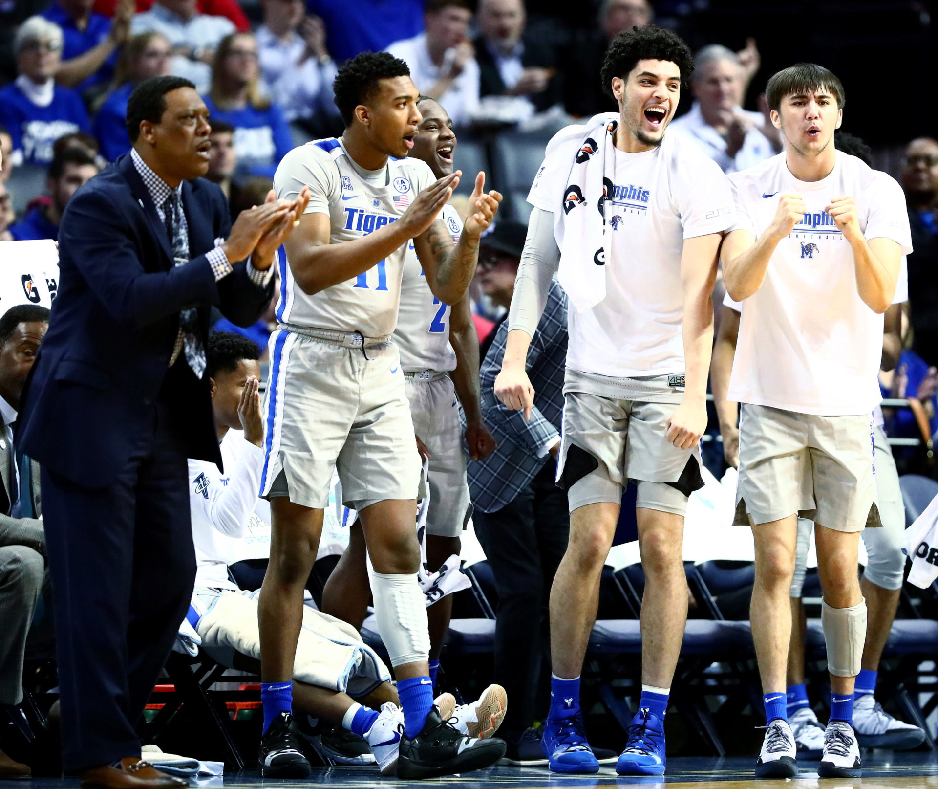 <strong>Memphis Tigers junior forward Isaiah Maurice (14) celebrates with the Tigers bench after senior forward Mike Parks Jr. (10) dunks the ball against the Cincinnati Bearcats on Thursday, Feb. 7, 2019.</strong> (Houston Cofield/Daily Memphian)