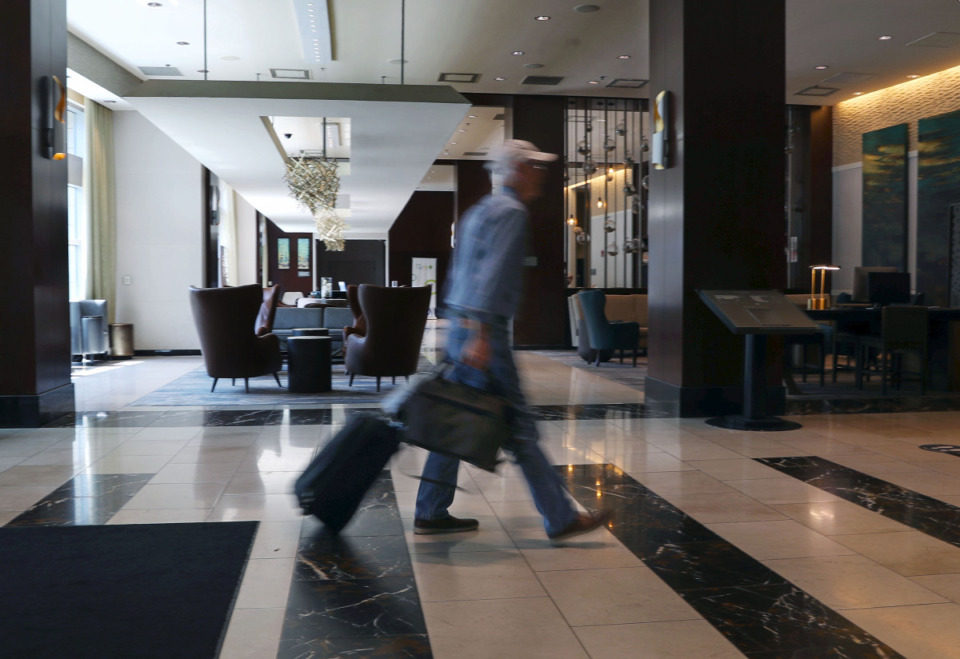 <strong>A customer walks through the recently remodeled lobby of the Westin Hotel in Downtown Memphis Aug. 27, 2021.</strong> (Patrick Lantrip/Daily Memphian)