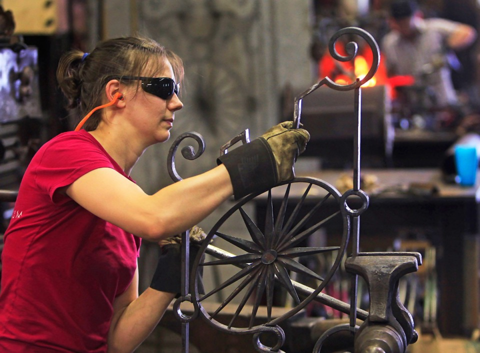 <strong>Mary Catherine Floyd works on a decorative railing in the blacksmith shop at the Metal Museum.</strong> (Daily Memphian file)