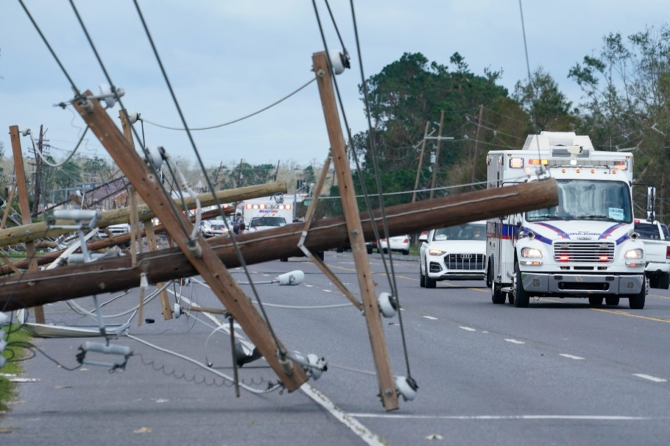 <strong>Downed power poles remain Monday, Aug. 30, after Hurricane Ida moved through LaPlace, La.</strong> (Steve Helber/Associated Press)