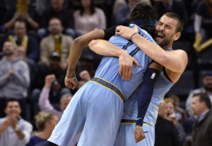 <strong>Memphis Grizzlies center Marc Gasol lifts guard Mike Conley (11) as they celebrate in the second half of a game against the Indiana Pacers on Jan. 26, 2019, in Memphis.</strong> (AP Photo/Brandon Dill)
