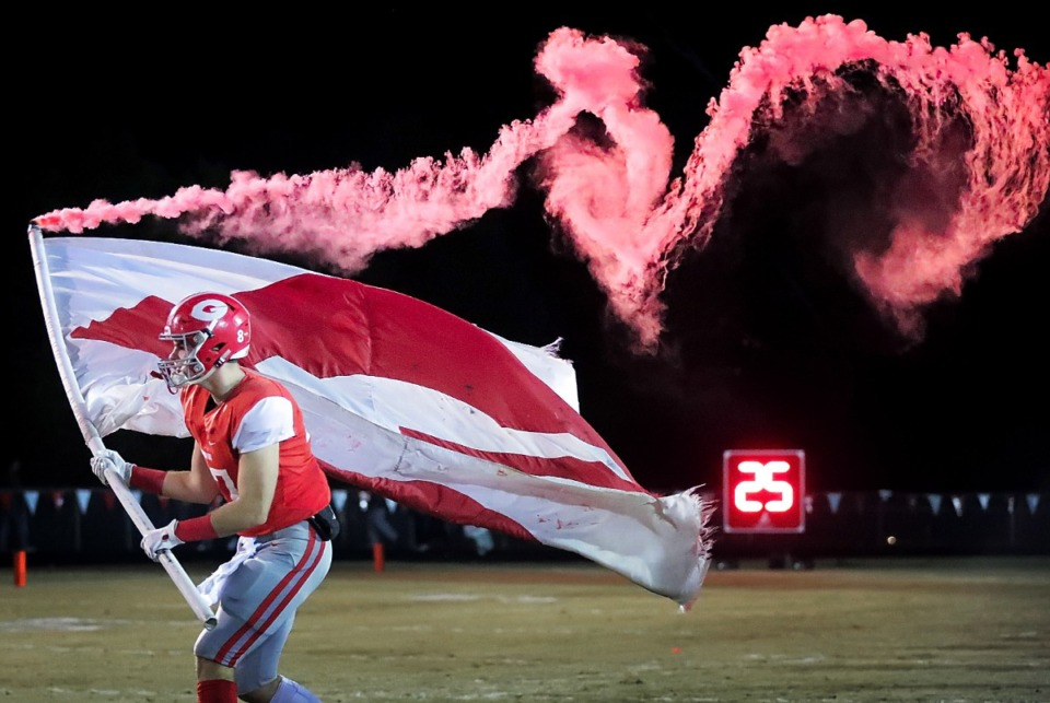 <strong>Germantown's Tyler Miller leads his team onto the field at the start of Germantown's game against Whitehaven at Germantown High School on Nov. 16, 2018.</strong> (Jim Weber/Daily Memphian file)