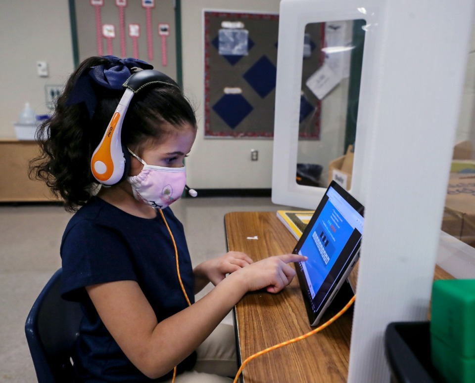 <strong>A masked Riverwood Elementary student works on her tablet March 1, 2021.</strong> (Patrick Lantrip/Daily Memphian file)