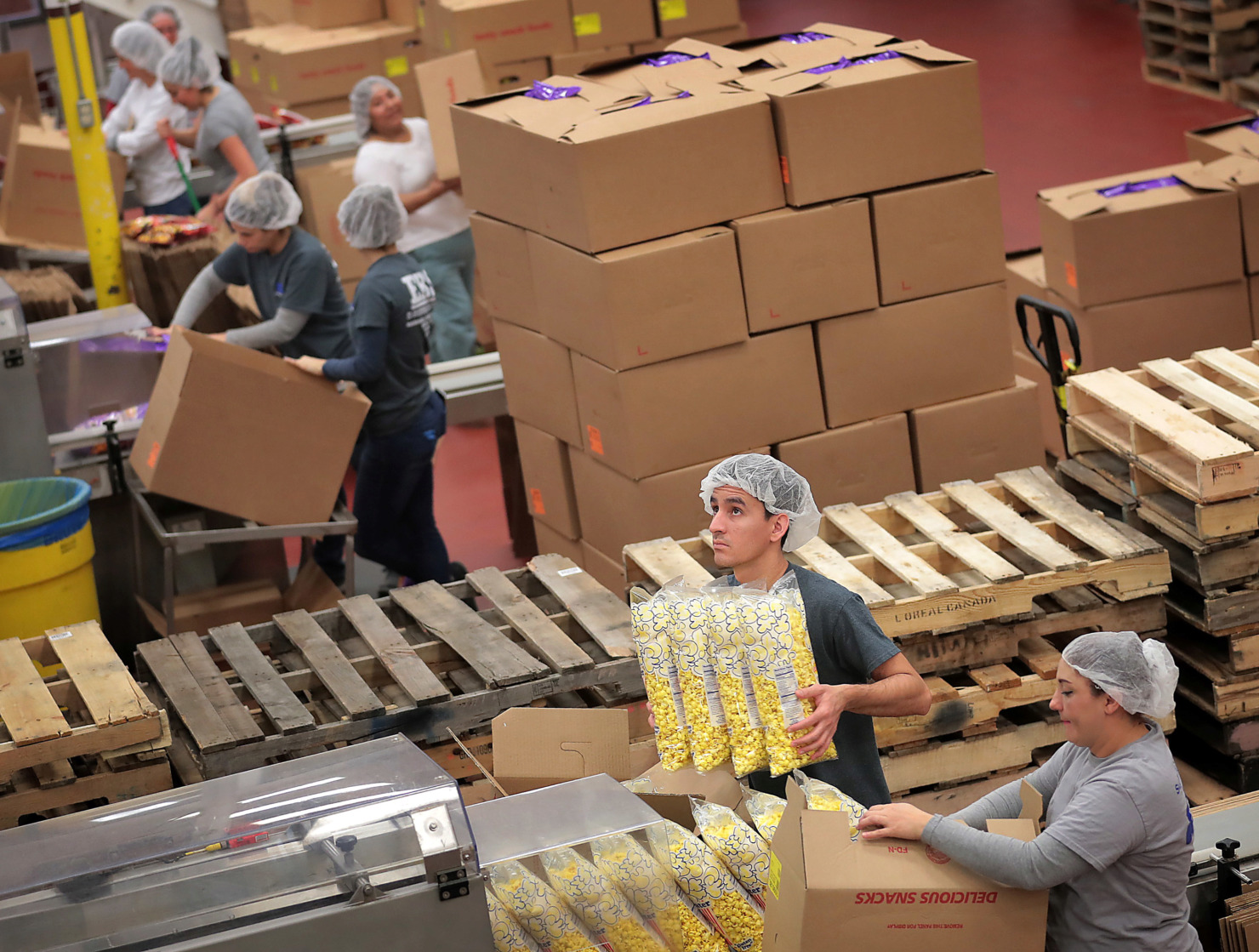 <strong>Workers make and package cheese puffs, pork rinds, and popcorn among other snacks at the Brimhall Foods Company production facility in Bartlett where Brim's Snack Foods are made.</strong> (Jim Weber/Daily Memphian)
