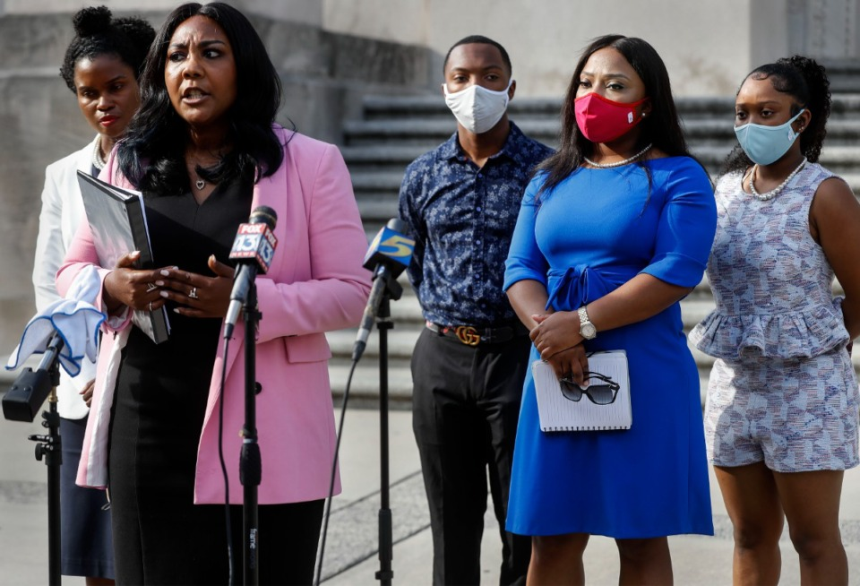 <strong>State Sen. Katrina Robinson (second from right, with her family and attorneys at a July 29, 2020, press conference) has been charged with theft and embezzlement involving government programs and wire fraud.</strong> (Mark Weber/Daily Memphian file)