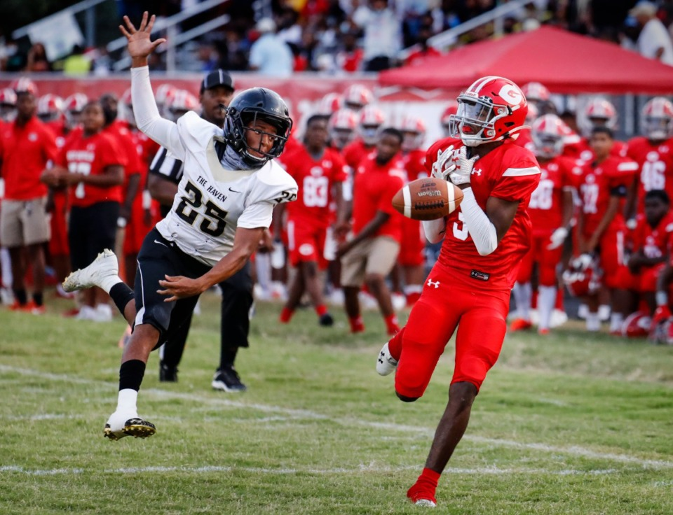 <strong>Germantown receiver Rayquon Williams (right) can&rsquo;t hang onto a reception in front of Whitehaven&rsquo;s Zyress Short (left) on Friday, Sept. 3.</strong> (Mark Weber/The Daily Memphian)