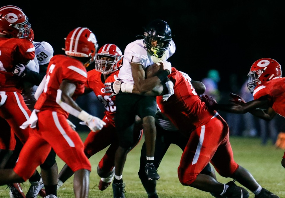 <strong>Whitehaven running back JaQuez Bradley (middle) is taken down by the Germantown defense on Friday, Sept. 3.</strong> (Mark Weber/The Daily Memphian)