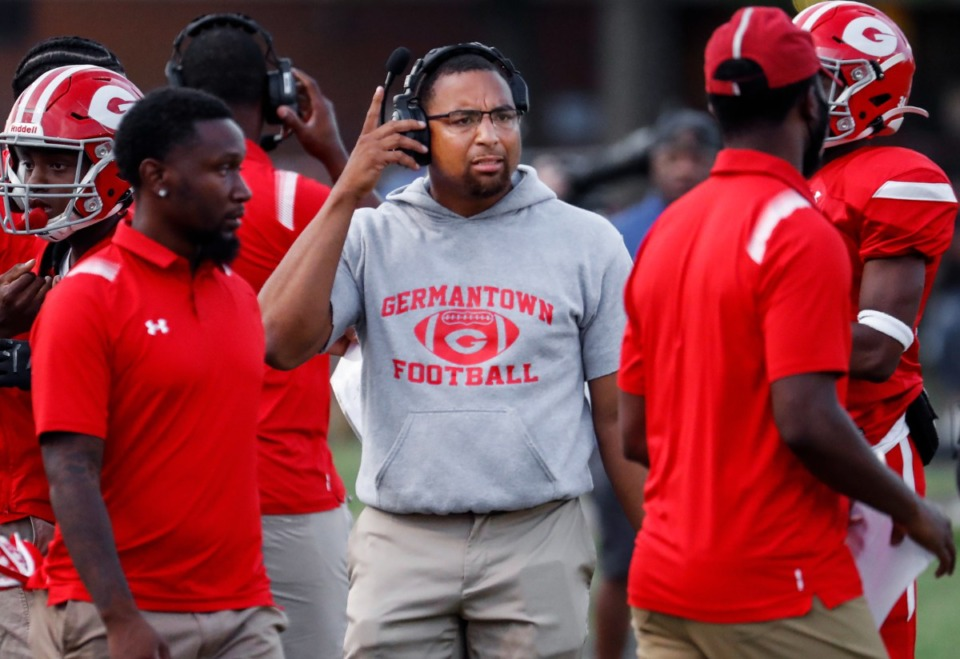 <strong>Germantown head coach Gene Robinson (middle) talks to his players in the game against Whitehaven on Friday, Sept. 3.</strong> (Mark Weber/The Daily Memphian)