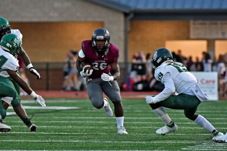 <strong>Collierville running back Andy Bell (26) charges up the middles while White Station's Gregory Mangle (19) goes in for a tackle on Friday, Sept. 3, 2021.</strong> (Justin Ford/Special to The Daily Memphian)
