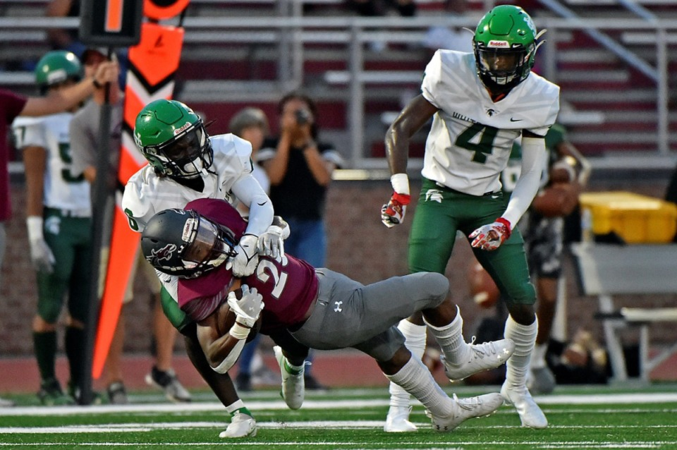 <strong>A Collierville back is taken down by a couple of White Station Spartans, including Shamari Covington (4), on Friday, Sept. 3, 2021.</strong> (Justin Ford/Special to The Daily Memphian)