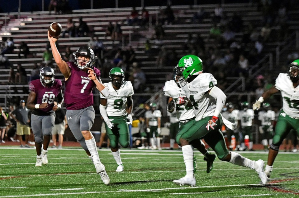 <strong>Collierville quarterback Houston Wilhelm (7) throws a pass under pressure from White Station on Friday, Sept. 3, 2021.</strong> (Justin Ford/Special to The Daily Memphian)