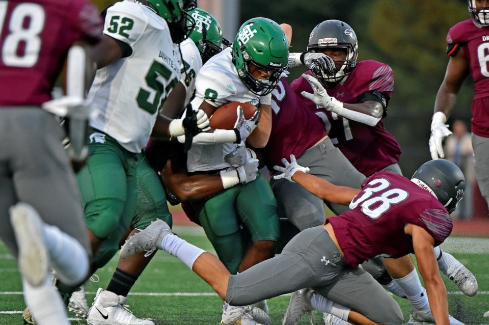 <strong>A White Station drive is brought to a halt amid a scrum of Collierville players on Friday, Sept. 3, 2021.</strong> (Justin Ford/Special to The Daily Memphian)