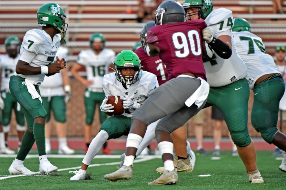 <strong>White Station quarterback Braylen Ragland (7) looks on as Eli Webster (74) keeps Collierville's Antonio Chambers (90) from sacking the ball carrier on Friday, Sept. 3, 2021.</strong> (Justin Ford/Special to The Daily Memphian)