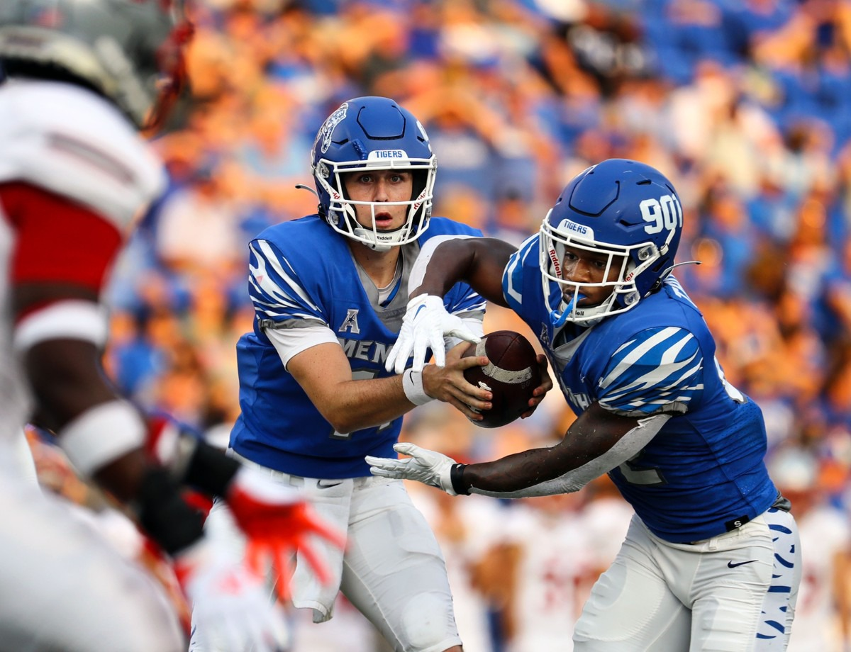 <strong>University of Memphis quarterback Seth Henigan hands the ball off to running back Brandon Thomas during a Sept. 4, 2021 game against Nicholls State at Liberty Bowl Memorial Stadium. Henigan became the first freshman quarterback in school history to start in a season opener for the Tigers, and he led them to a 42-17 win.</strong> (Patrick Lantrip/Daily Memphian)