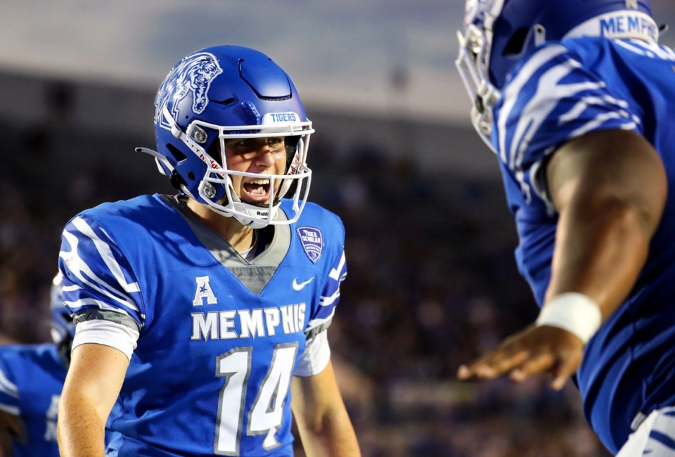 <strong>University of Memphis quarterback Seth Henigan celebrates with offensive lineman Jakari Robinson after a touchdown during a Sept. 4, 2021 game against Nicholls State at Liberty Bowl Memorial Stadium.</strong> (Patrick Lantrip/Daily Memphian)