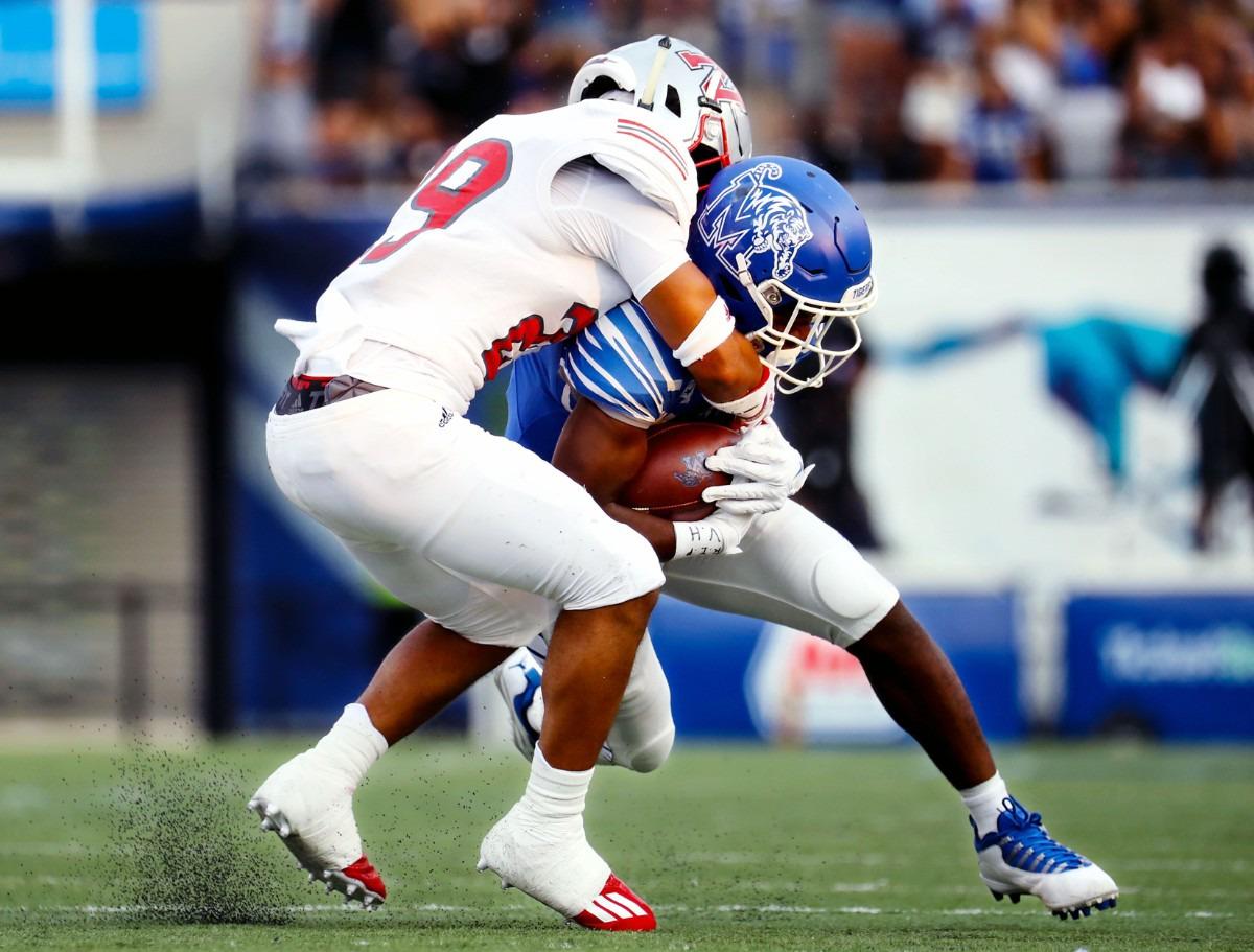 <strong>University of Memphis running back Asa Martin (28) gets tackled during a Sept. 4, 2021 game against Nicholls State at Liberty Bowl Memorial Stadium.</strong> (Patrick Lantrip/Daily Memphian)
