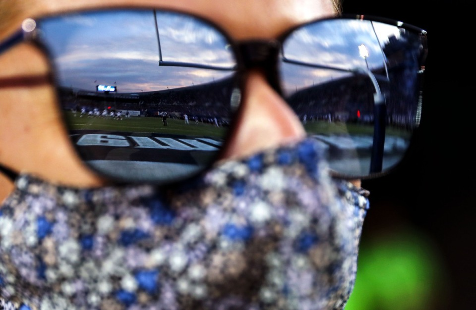 <strong>The sun sets over Liberty Bowl Memorial Stadium as Jenny Pallme watches the University of Memphis play Nicholls State on Saturday, Sept. 4, 2021.</strong> (Patrick Lantrip/Daily Memphian)