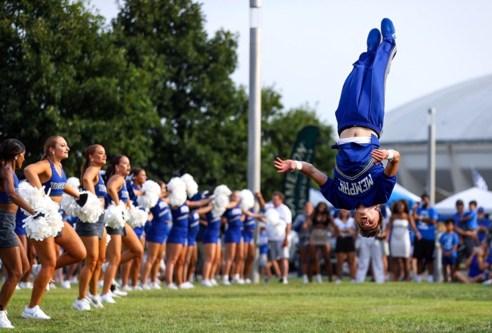 <strong>University of Memphis cheerleaders pump up the crowd on the Tiger Lane Saturday afternoon before the game.</strong> (Patrick Lantrip/Daily Memphian)