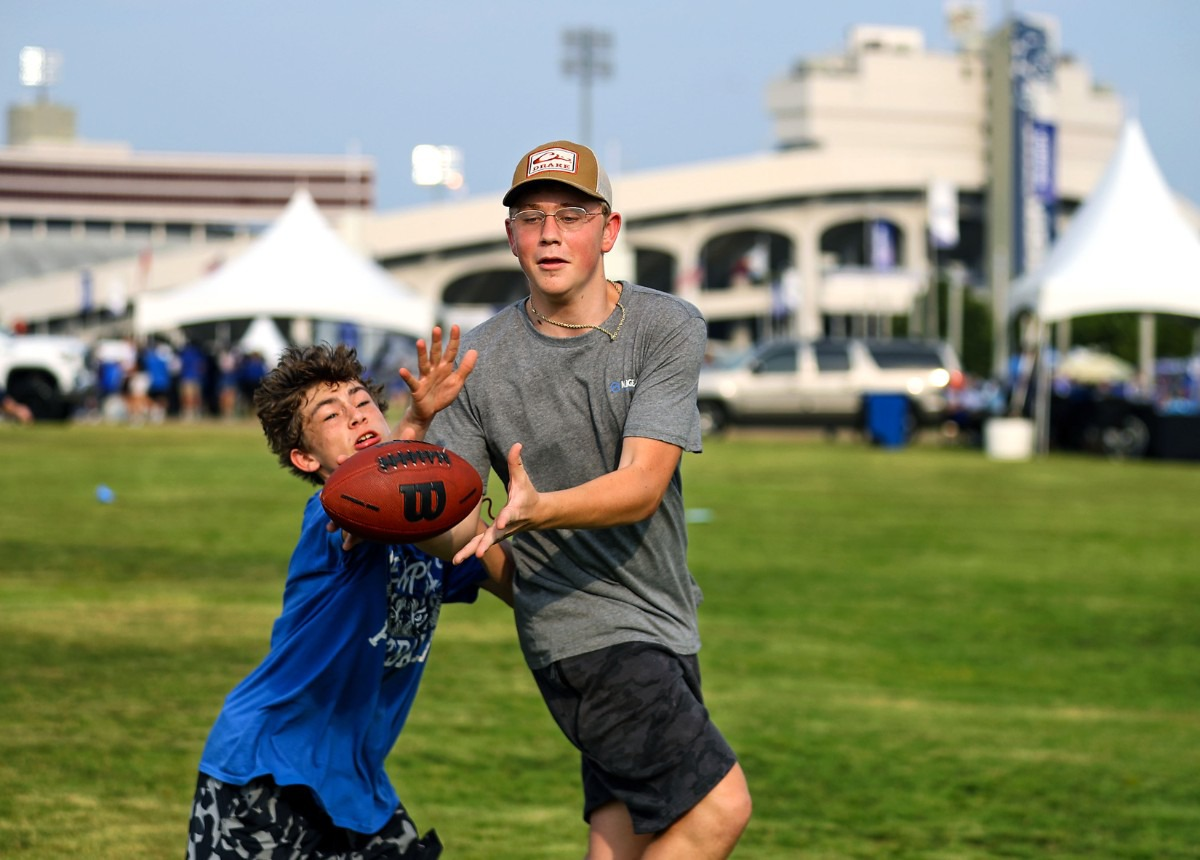 <strong>Shane Henley and Brayden Erwin play a game of catch in Tiger Lane before the Sept. 4, 2021 University of Memphis game against Nicholls State.</strong> (Patrick Lantrip/Daily Memphian)