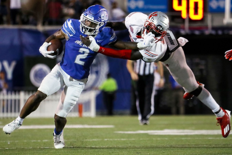 <strong>University of Memphis dunning back Rodrigues Clark (2) breaks a tackle during a Sept. 4, 2021 game against Nicholls State at Liberty Bowl Memorial Stadium.</strong> (Patrick Lantrip/Daily Memphian)