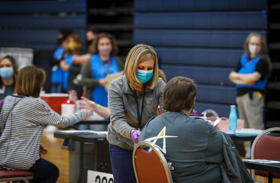 <strong>Volunteers administer vaccines to municipal and school employees from Arlington, Millington and Lakeland March 26, 2021.</strong> (Mark Weber/The Daily Memphian file)