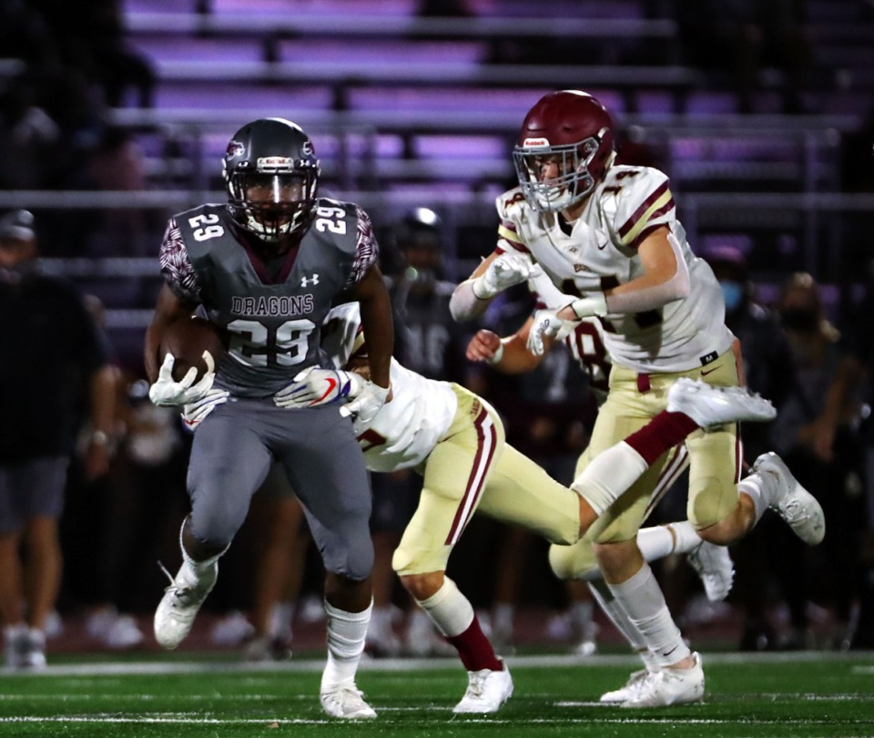 <strong>Collierville High School running back Troy Martin (29) breaks a tackle during a Sept. 25, 2020 home game against Evangelical Christian School.</strong> (Patrick Lantrip/Daily Memphian file)