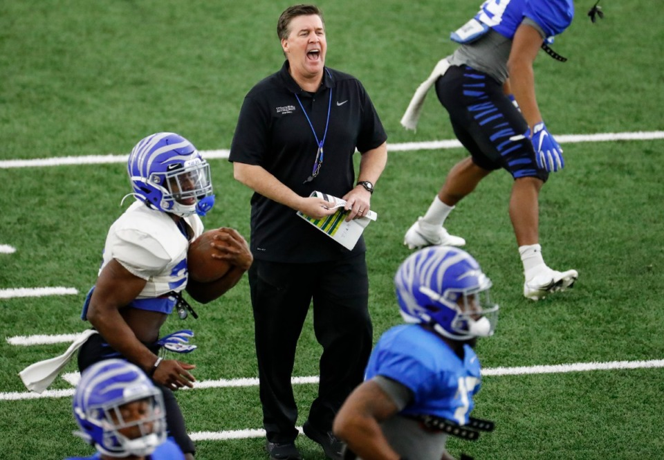 <strong>Memphis defensive coordinator Mike MacIntyre (middle, in March) had his first year at U of M complicated by COVID.</strong>&nbsp;(Mark Weber/The Daily Memphian file)