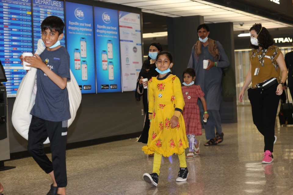 <strong>Afghan refugees arrive at Dulles International Airport on Aug. 31 in Dulles, Virginia. The City Council passed a resolution welcoming Afghan and Haitian refugees.&nbsp;</strong>(mpi34/MediaPunch /IPX)