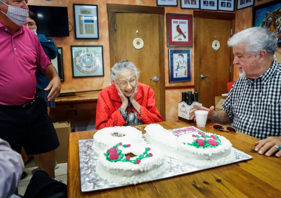 <strong>Louise Rooke (middle) reacts to her doughnut cake while celebrating her 98th birthday at Gibson's Donuts on Monday, Sept. 6, 2021. Rooke has visited the doughnut shop almost daily for over 30 years.</strong> (Mark Weber/The Daily Memphian)
