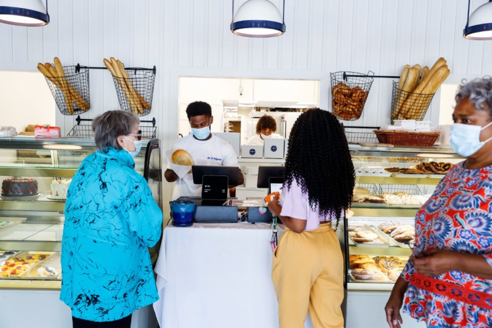 <strong>La Baguette customers order at the bakery&rsquo;s new front counter, on Wednesday, Sept. 8. It includes a window opening with a view into the baking area.</strong> (Mark Weber/The Daily Memphian)