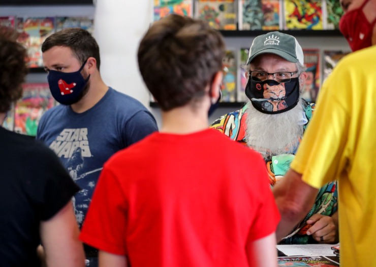 The co-owners of 901 Comics, Jaime Wright (left) and Shannon Merritt, help customers check out on Aug. 28 at the shop's Cordova location. (Patrick Lantrip/Daily Memphian)