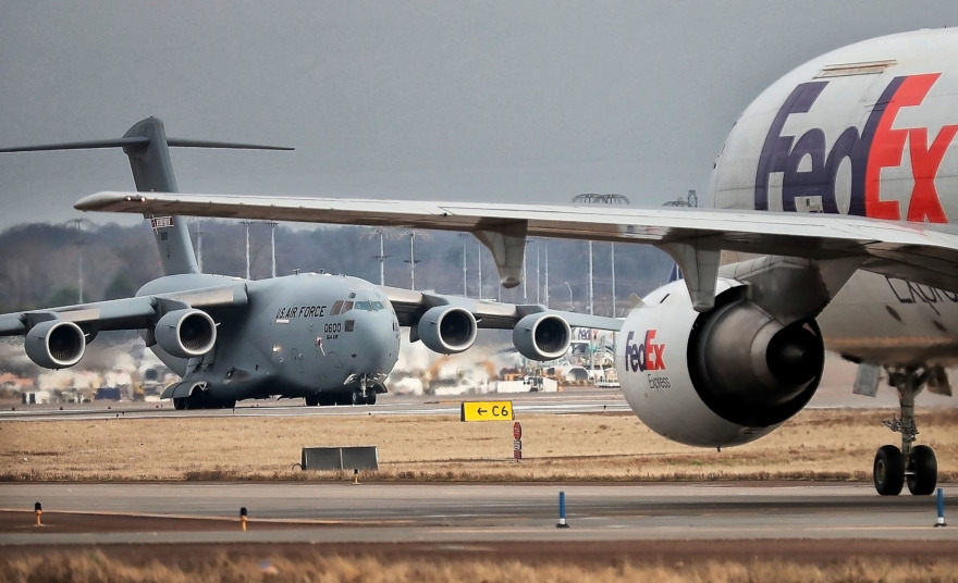 <strong>FedEx planes land throughout the day as Memphians get a close look at Memphis International Airport during the first Jon K. Thompson World Class Tour of 2019. More than 2,000 people have taken the free tours, which have been offered for many years.</strong> (Jim Weber/Daily Memphian)